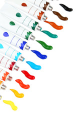 Colorful acrylic paints in tubes on white background