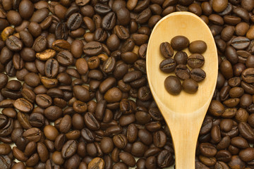 wooden spoon on coffee beans background