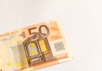 Paper money from fifty euro on white background