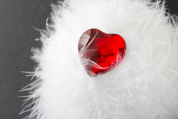 stone heart on a white fluff