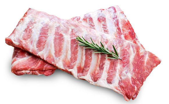 Raw  Pork ribs with a rosemary isolated on white
