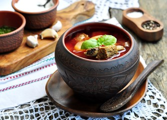 Ukrainian soup from vegetables Borsch on a wooden table.