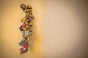 Love couples padlocks on Ponte Vecchio (Old Bridge) in Florence, Italy