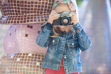 Beautiful smiling girl holding a camera