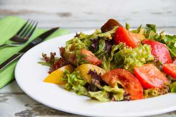 salad of three types tomato with lettuce and sauce
