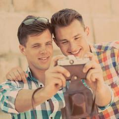 Two boys with retro photo camera