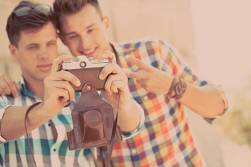 Two boys with retro photo camera