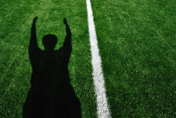 Shadow of American Football Referee Signaling Touchdown Wall mural