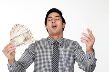 紙幣を持つ笑顔の男性 Fototapete