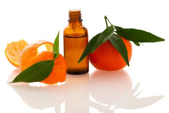 Essential oil of orange mandarin citrus fruit in little bottle d