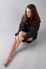 Woman in Oversize Men's Shirt with Bare Legs and Feet