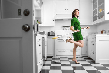 Happy fun dancing housewife housekeeping kitchen clean immaculate joyful pleasant lifestyle