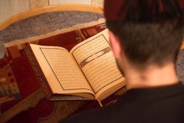 Muslim man reading the koran surah yasin