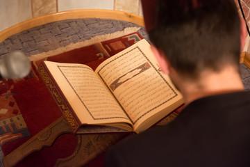 Muslim man reading the koran
