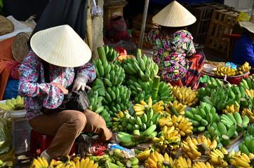 Seller on the colour market in Vietnam