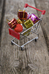 Shopping cart with gifts and heart