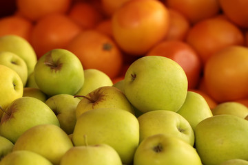Fresh yellow apples and oranges