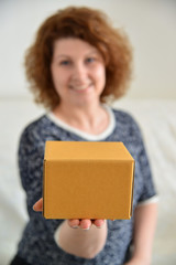 picture of attractive woman with cardboard box