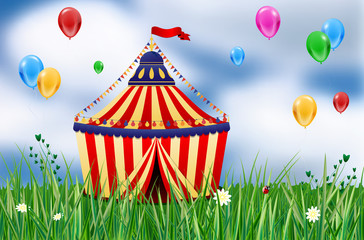 Circus tent on meadow and flying balloons