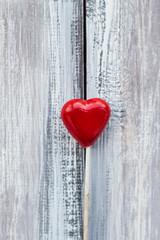 Red lollipop shape heart wooden background