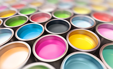paint buckets with focus on cmyk paint