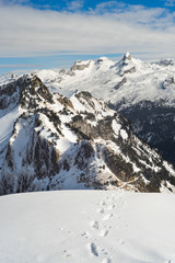 Winter landscape in the Swiss Alps with footprints in the foreground, Stoos, Switzerland