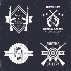 guns and ammo, vintage logo, badge with automatic rifles, crossed revolvers, two pistols, shooting gallery logo, sign with assault