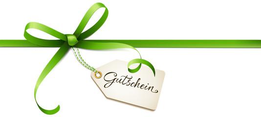 Grüne Schleife mit Gutschein Etikett