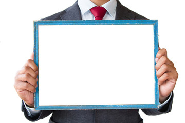 Businessman holding blank picture frame in vertical, portrait. isolated white background.