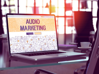 Audio Marketing Concept. Closeup Landing Page on Laptop Screen in Doodle Design Style. On background of Comfortable Working Place in Modern Office. Blurred, Toned Image. 3D Render.