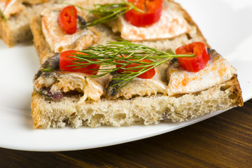 sandwiches with herring, red pepper and dill