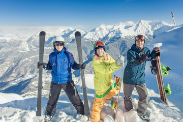 Inspired group of snowboarders at summit
