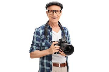Senior photographer holding a black camera