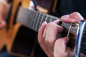 Practicing in playing guitar, Hand of young men playing guitar c