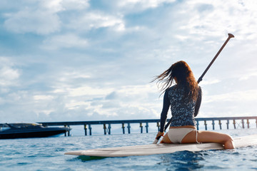 Travel Adventure. Woman Paddling On Surfing Board. Recreation, Water Sports