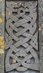 Old stone carved Celtic dragons design