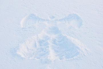 print of angel on the snow surface