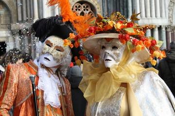 Italy, carnival mask in Venice posing in san marco square