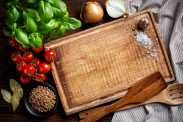 Zelfklevend Fotobehang Koken cooking background with old cutting board