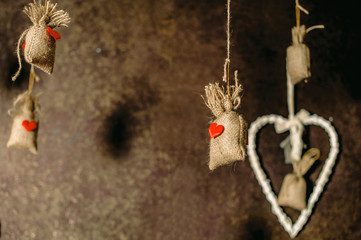 a sackcloth bags with red heart hanging on cord