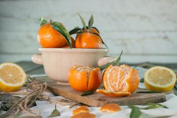Mandarins and lemon on wooden table