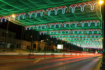 Wall Mural - Street in Muscat decorated with lights