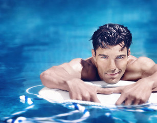 Handsome man in pool