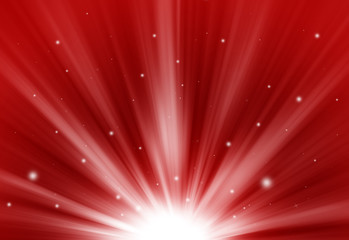 Red glitter sparkle defocused rays lights bokeh abstract chistmas background.