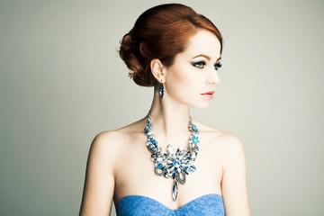 Beautiful woman with evening make-up. Jewelry and Beauty. Fashion photo