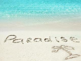 "Inscription ""Paradise"" in the sand on a tropical island,  Maldiv"