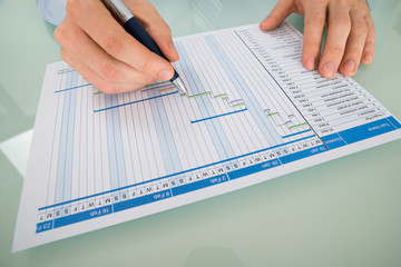 Businessman Working On Gantt Chart At Desk