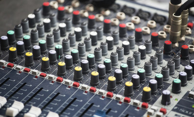 Sound console with colorful equalizer levels dials