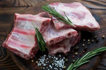 Close-up of raw fresh pork ribs, selective focus, studio shot