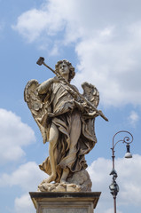 marble statue of angel from the Sant'Angelo Bridge in Rome, Italy
